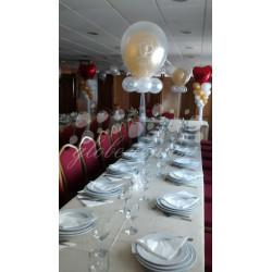 Centro de mesa con globo cristal con corazones
